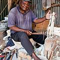 Kenya. December 10th. A Man Carving Figures In Wood. by Michal Bednarek