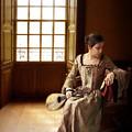 Lady In 16th Century Clothing With A Mandolin by Jill Battaglia