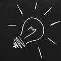 Light Bulb On A Chalkboard by Chevy Fleet