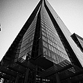 looking up at the shard building London England UK by Joe Fox