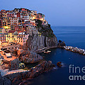 Manarola At Night In The Cinque Terre Italy by Matteo Colombo