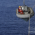 Sailors Lower A Rigid-hull Inflatable by Stocktrek Images