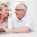 Senior Couple Using Laptop by Science Photo Library