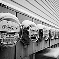 snow covered electricity meters in Saskatoon Saskatchewan Canada by Joe Fox