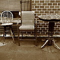 Table And Chairs by Frank Romeo