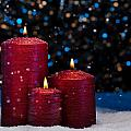 Three Red Candles In Snow  by U Schade