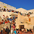 Waiting For The Sunset In Oia Town by George Atsametakis