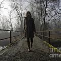 Woman Walking On A Bridge by Mats Silvan