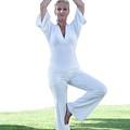 Yoga by Ian Hooton/science Photo Library