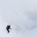 Young Man Skiing In Deep Powder by Henry Georgi