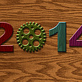 2014 Wooden Gear On Wood Grain Texture Background by Jit Lim