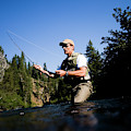A Fly-fisherman In The Truckee River by Jay Reilly