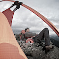 A Man Setting Up A Tent by Celin Serbo