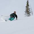 A Skier Descends A Snowy Slope by Jose Azel
