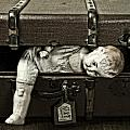 Doll In Suitcase by Joana Kruse