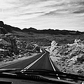 Driving Along The White Domes Road In Valley Of Fire State Park Nevada Usa by Joe Fox