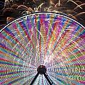 Ferris Wheel And Fireworks by Jim Corwin