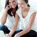 Mother And Teenage Daughter by Ian Hooton/science Photo Library