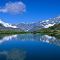 Reflection Of Mountains In Water by Panoramic Images
