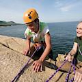 Rock Climbing On Oceanside Cliffs by Jose Azel