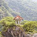 Traditional Pavillion Atop Cliff by Jannis Werner