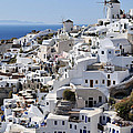 Windmills And White Houses In Oia by George Atsametakis