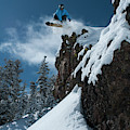 A Male Snowboarder Wearing A Bright by Jason Abraham
