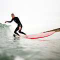 A Surfer Enjoys The Waves In Carlsbad by Jay Reilly