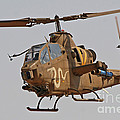 An Ah-1s Tzefa Attack Helicopter by Ofer Zidon