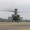 An Ah-64 Apache Helicopter In Midair by Terry Moore