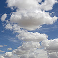 Clouds And Field by John Shaw