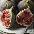 Delicious Figs On Wooden Background by Daniel Barbalata