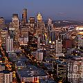 Seattle Skyline With Mount Rainier And Downtown City Lights by Jim Corwin