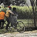 3 Young Children On A Cycle At The Side Of The Road by Ashish Agarwal
