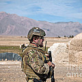 A Coalition Force Member Maintains by Stocktrek Images