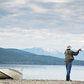 A Man Fishing On Whitefish Lake by Craig Moore