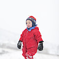 A Two Year Old Boy Plays In A Snowy by Steve Glass