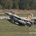 An F-16c Barak Of The Israeli Air Force by Ofer Zidon