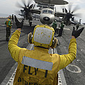 Aviation Boatswains Mate Directs An by Stocktrek Images
