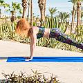Woman Doing Yoga by Nikita Buida