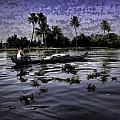Man Boating On A Salt Water Lagoon by Ashish Agarwal