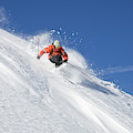 A Young Man Skis Untracked Powder by Henry Georgi