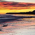Bamburgh Castle At Sunrise by David Pringle