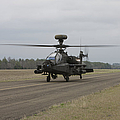 Ah-64 Apache Helicopter On The Runway by Terry Moore