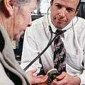 Measuring Blood Pressure by Jim Varney/science Photo Library