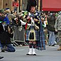 A Bagpiper Posing At The 2009 New York St. Patrick Day Parade by James Connor