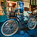 A Bike In Front Of Cafe Du Monde In New Orleans by Andy Crawford