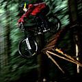 A Biker Rides His Mountain Bike by Scott Markewitz