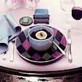 A Bowl Of Food On A Pink Table by Haanel Cassidy