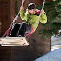 A Boy Plays Outside In Lake Tahoe by Corey Rich